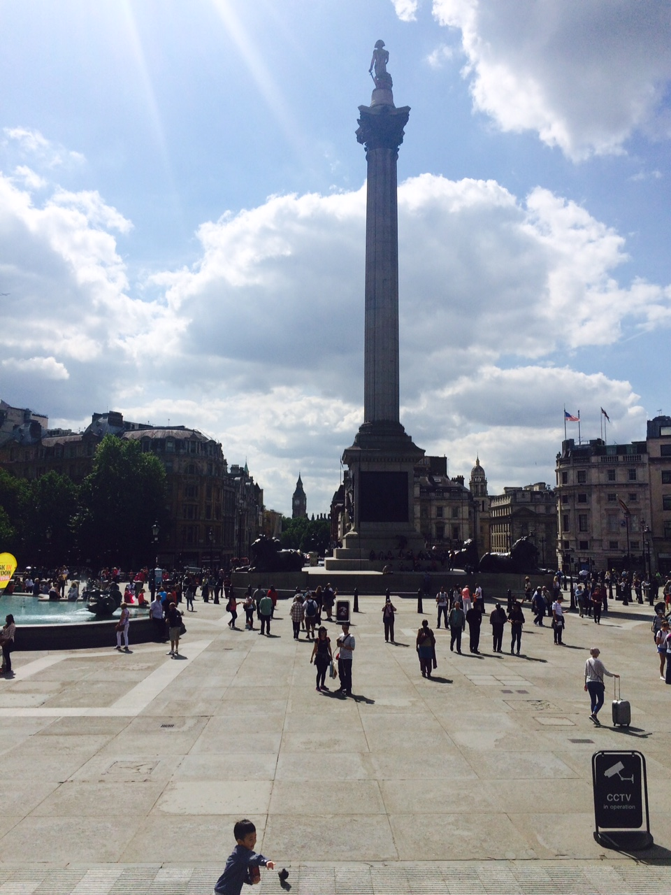Trafalger Square.  That's Lord Nelson with his back to you!  In the far distance, Big Ben.
